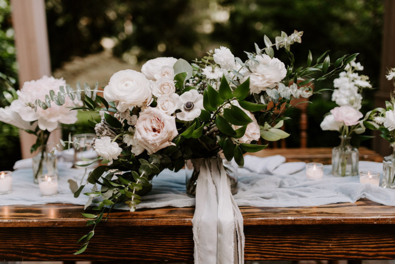 simple and romantic bouquet with white flowers and lots of greenery.