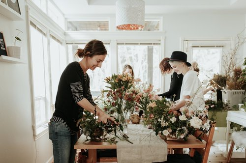 an austin florist designing and arranging flowers for a wedding