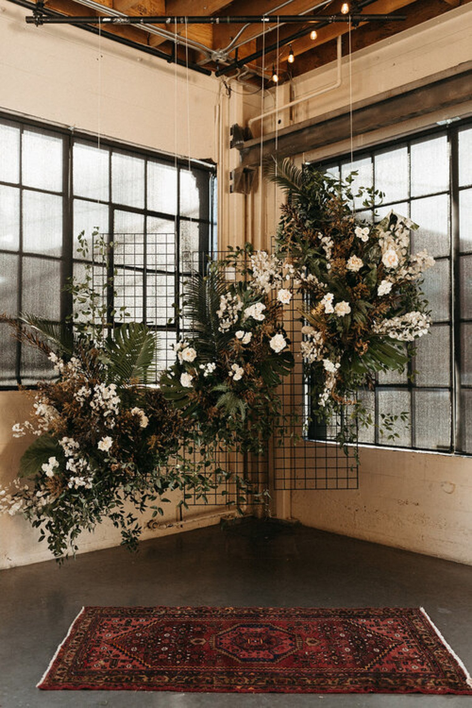 large, asymmetrical floral installation for a wedding ceremony