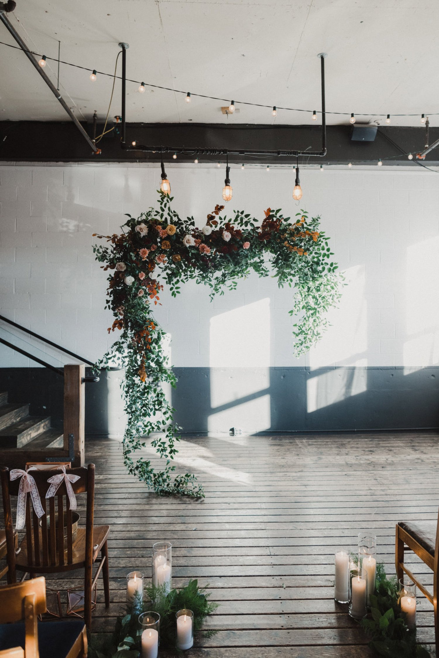hanging floral installation with trailing greenery and roses.