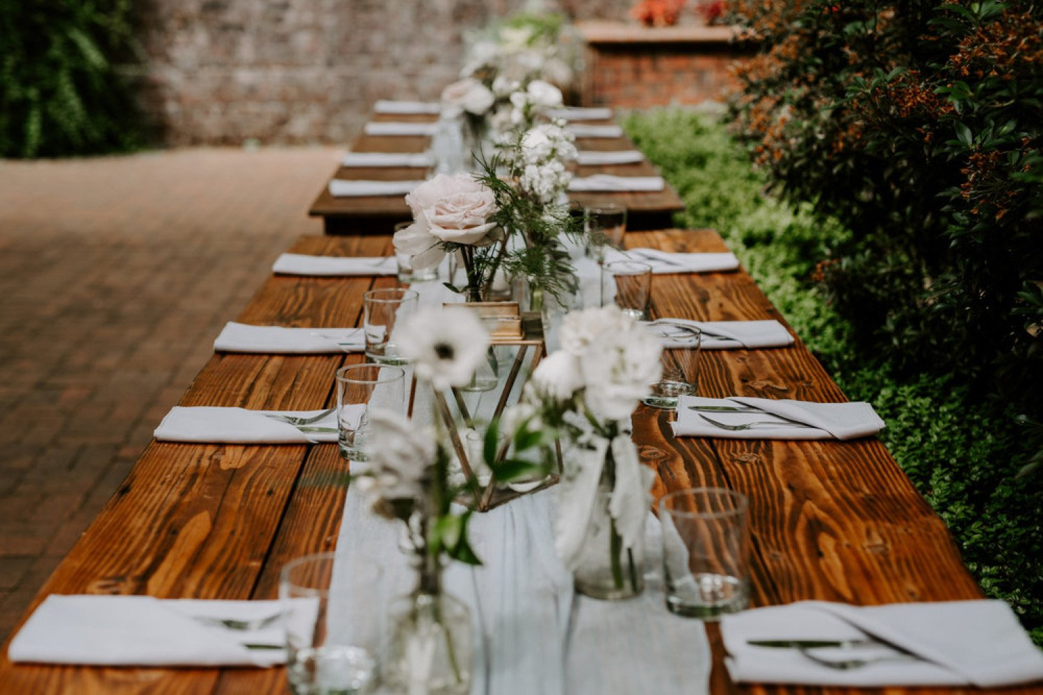 farm table with bud vases
