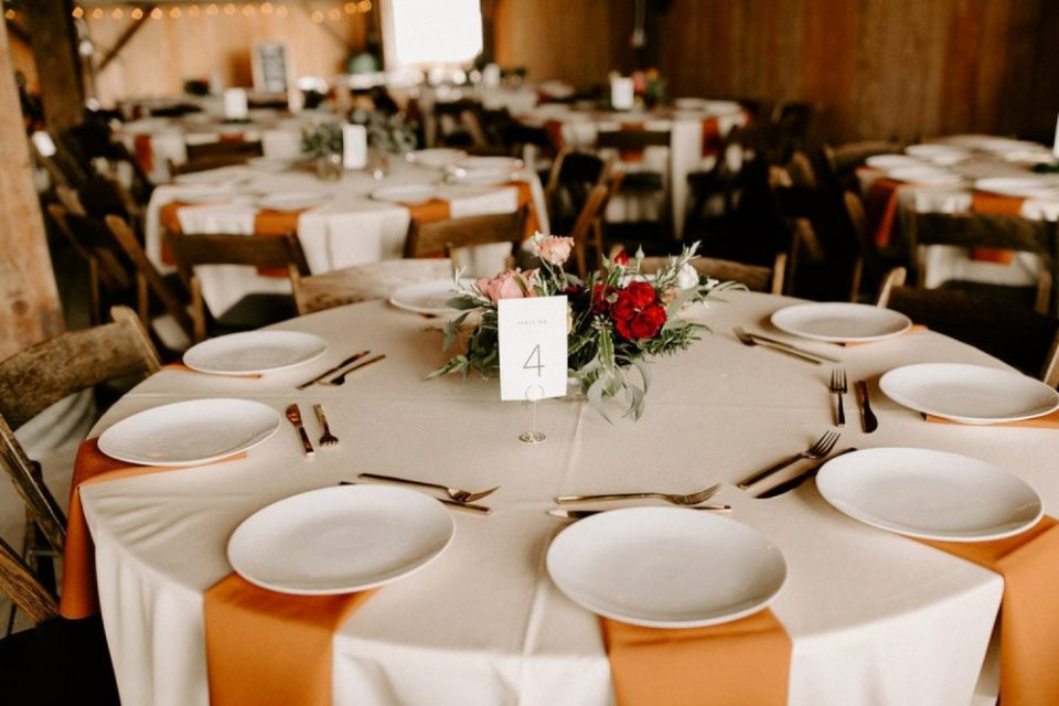 photo of a floral centerpiece on round wedding reception table