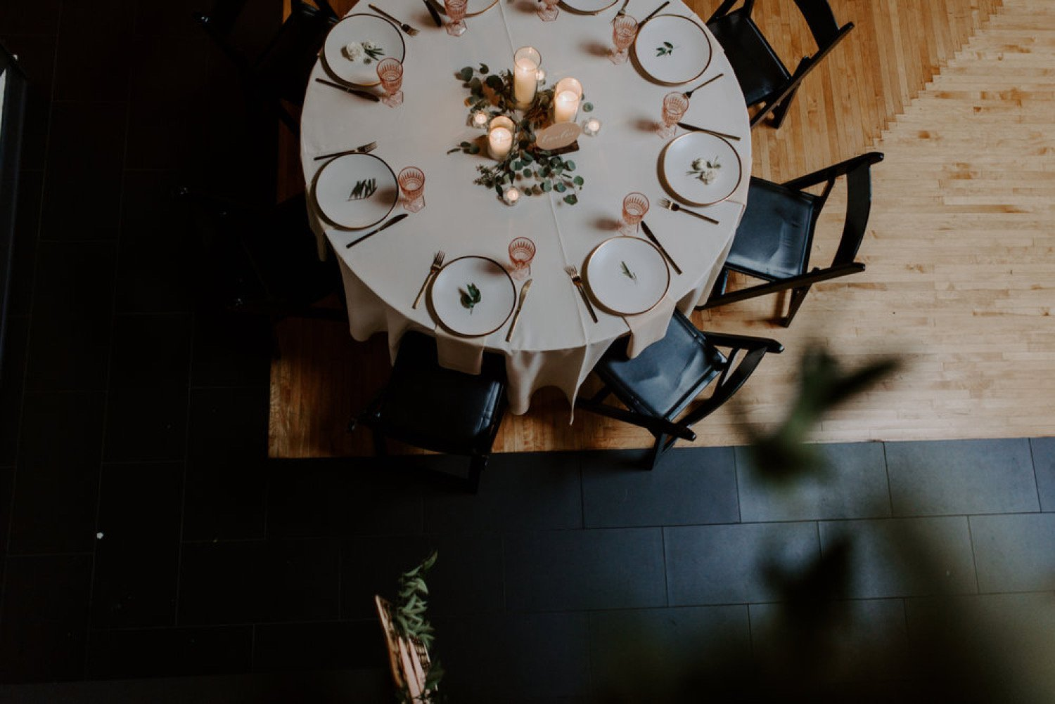 photo of  round wedding table with greenery and candles