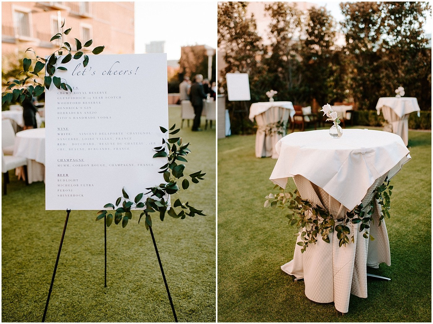 wedding sign and cocktail table decorated with airy greenery
