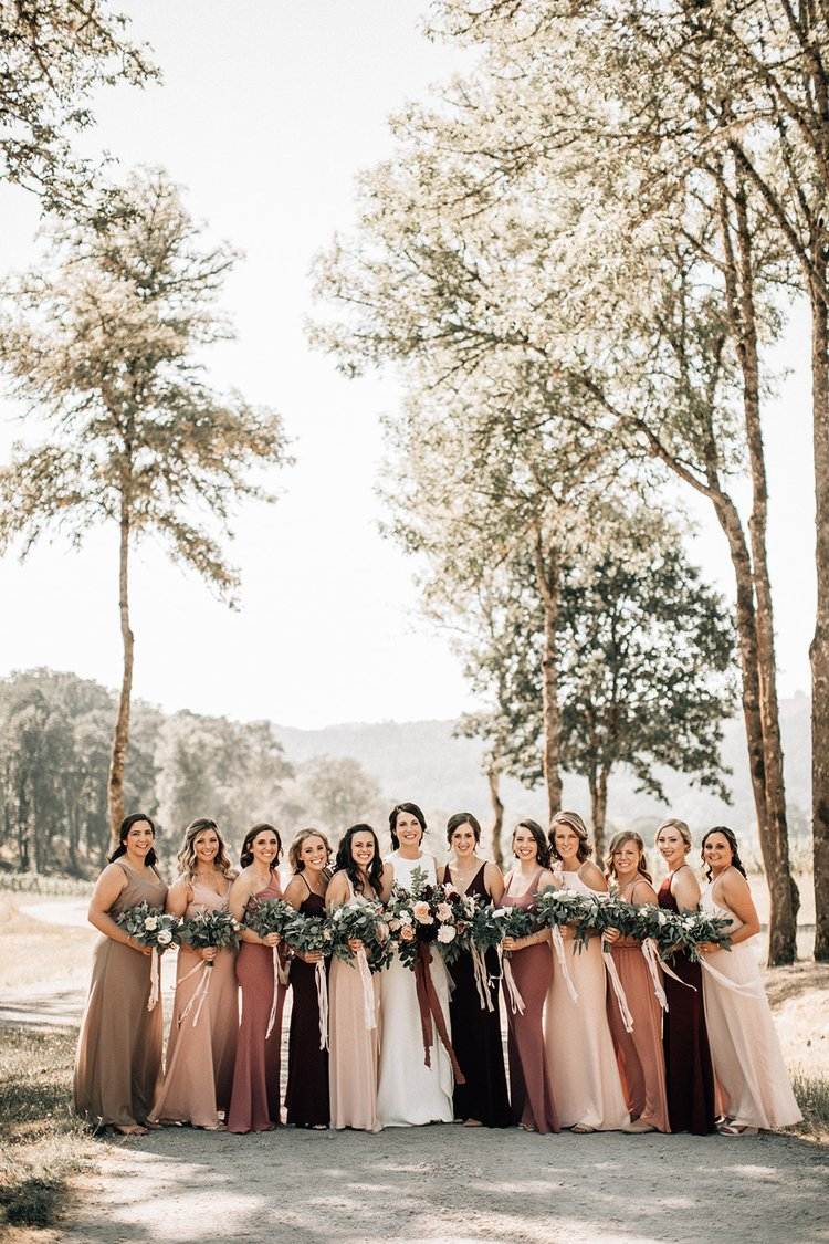 bridesmaids in mismatched blush and burgundy dresses