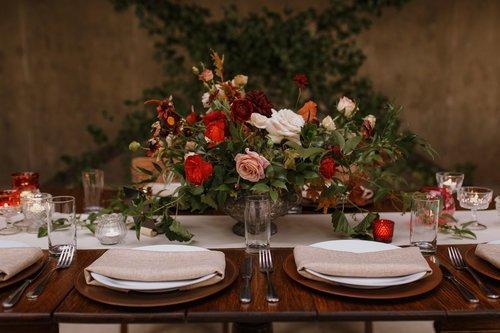 a wedding flower arrangement placed on a wedding reception table