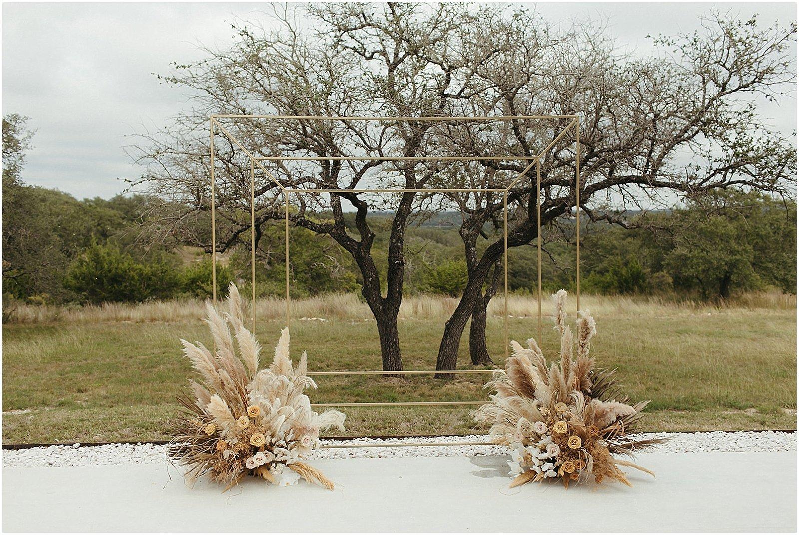 pampas grass wedding ceremony set up at mae's ridge texas wedding venue