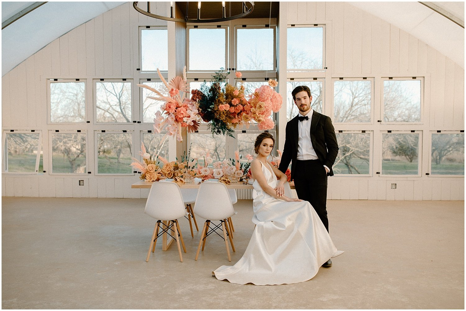 bride and grrom at wedding reception table with colorful florals at camino real ranch in texas