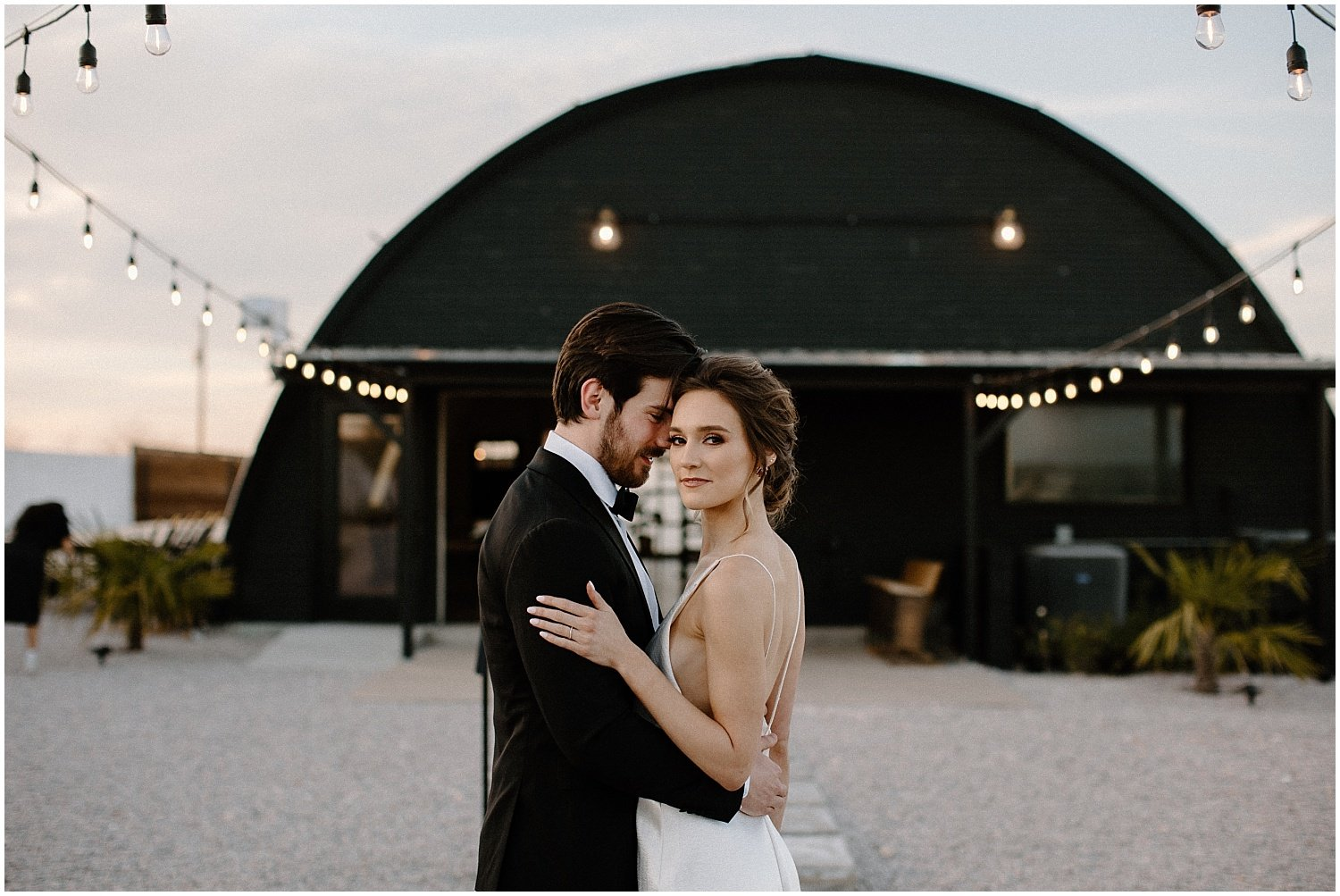 bride and groom portraits in front of camino real ranch wedding venue in texas
