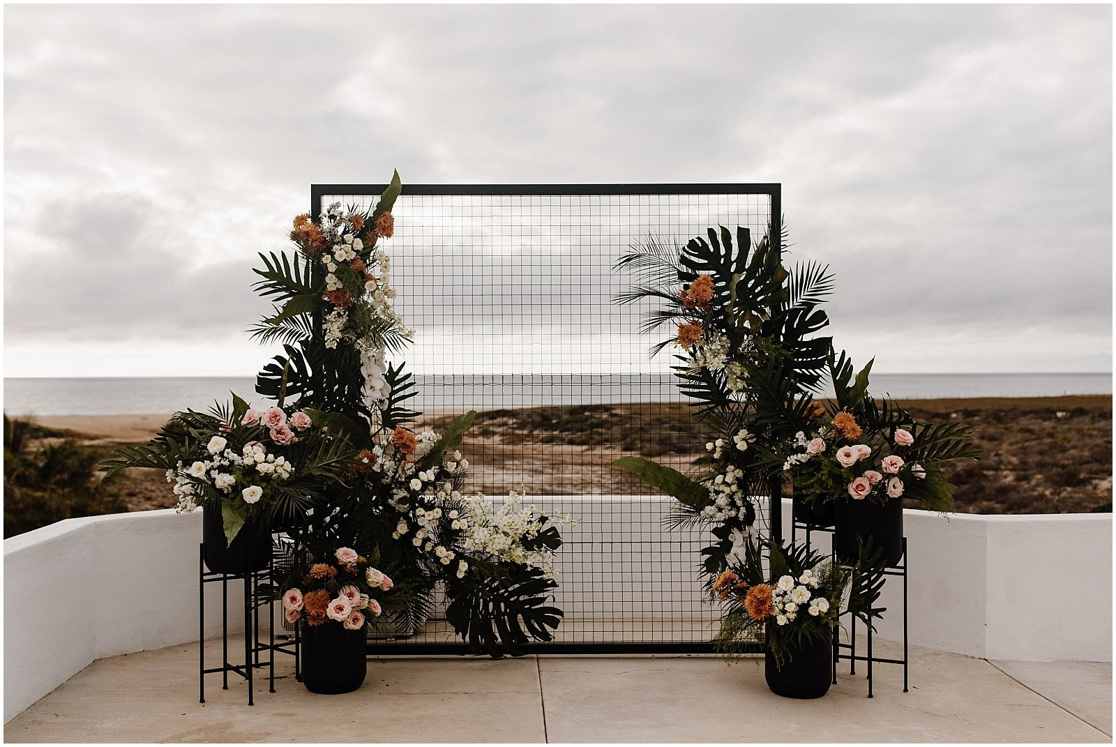 modern and tropical wedding ceremony backdrop at Pachamama Resort in Todos Santos, Mexico
