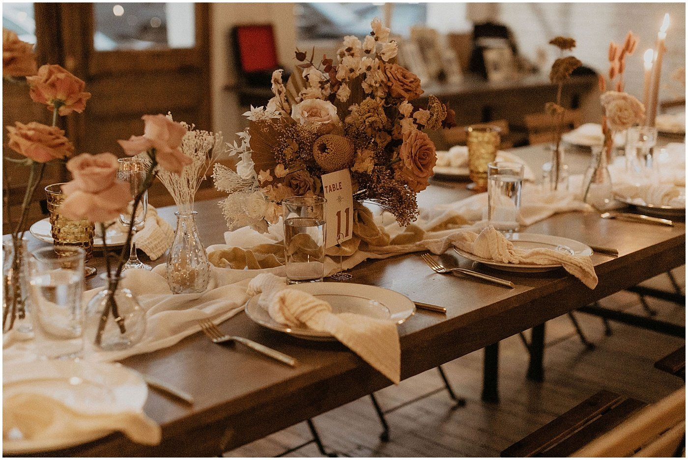 floral centerpieces on wedding reception tables at one eleven east