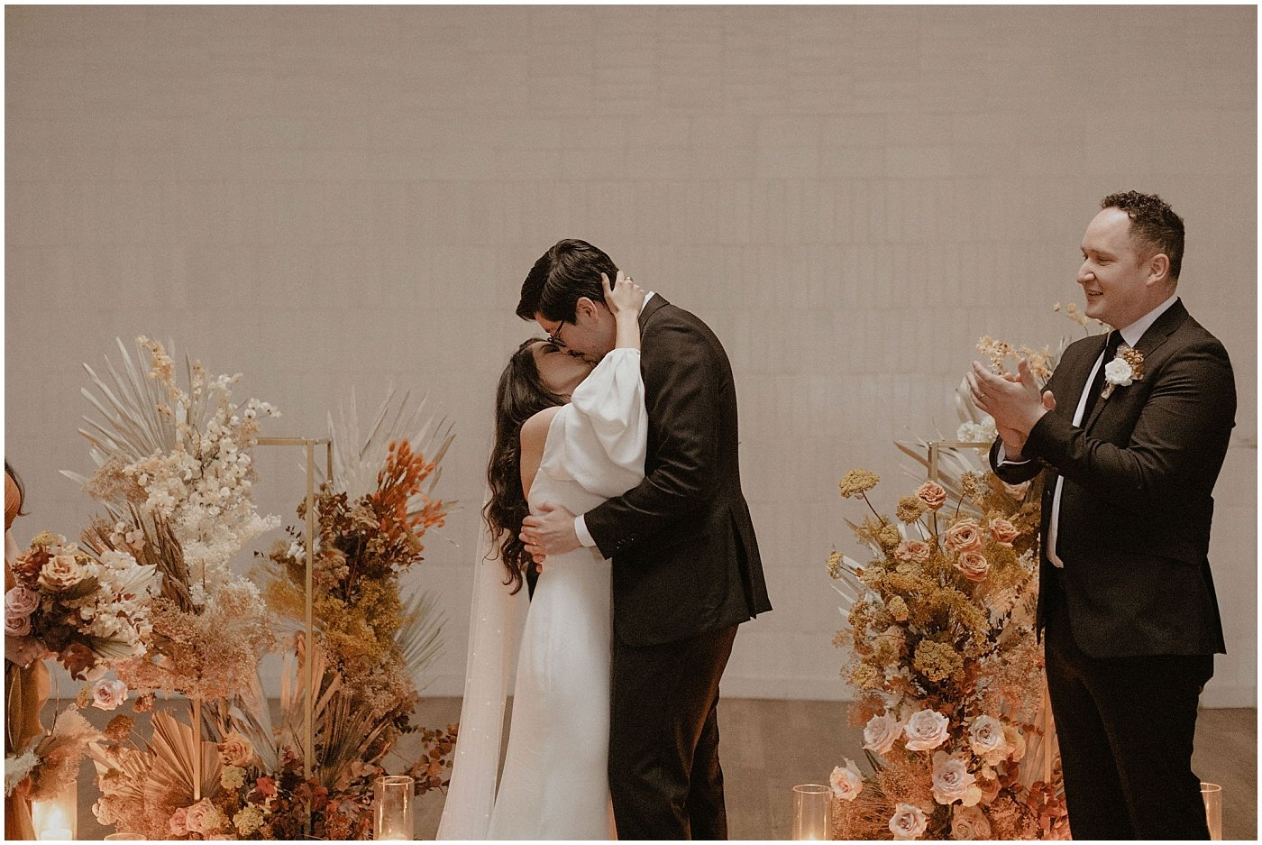 bride and groom kissing after their wedding ceremony at one eleven east