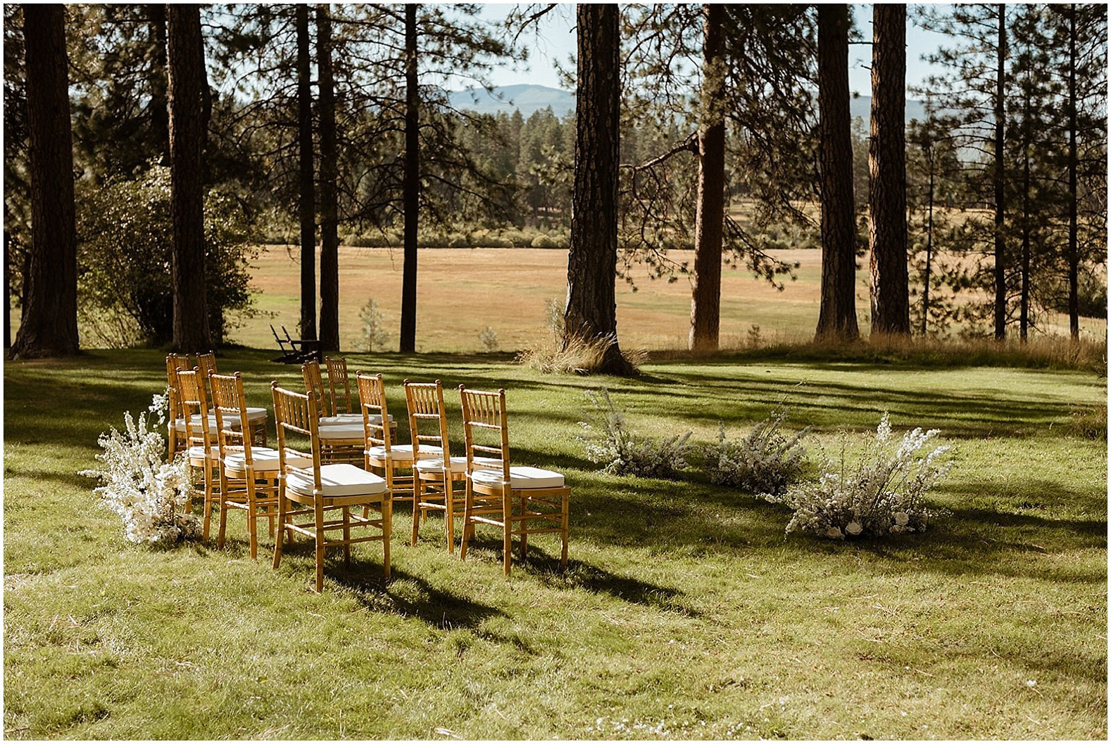 white and blush floral arrangements at ceremony location for an Oregon Wedding at House on Metolius