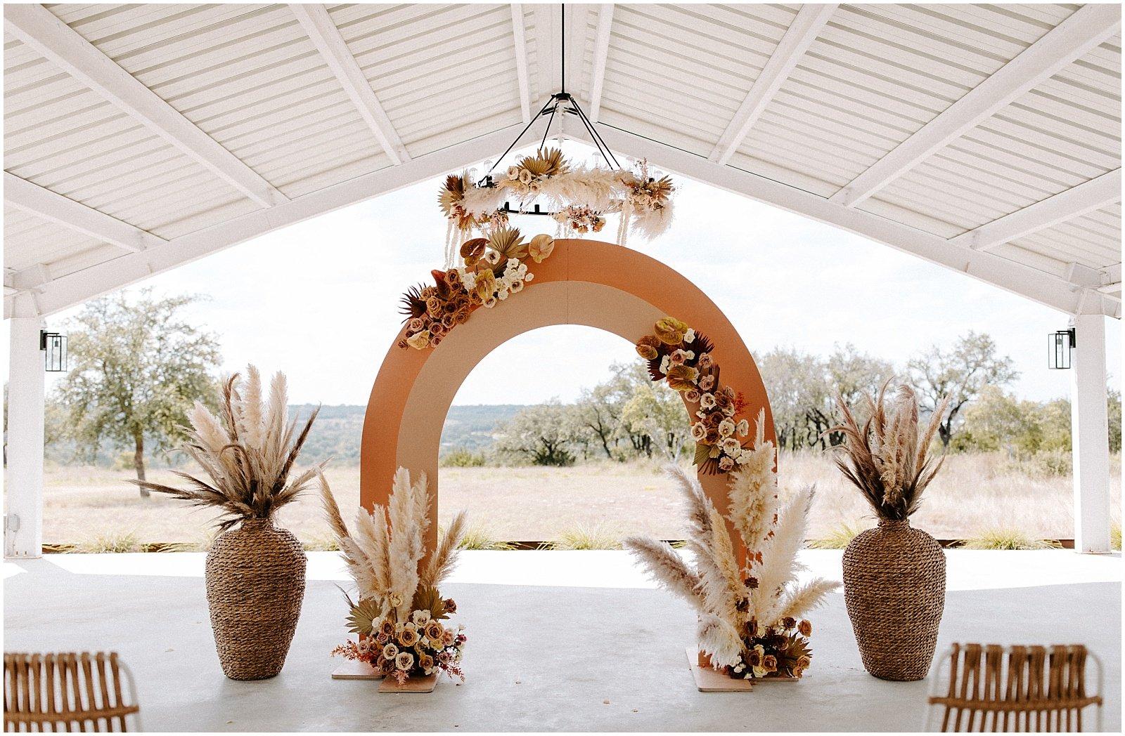 modern boho wedding ceremony set up at mae's ridge