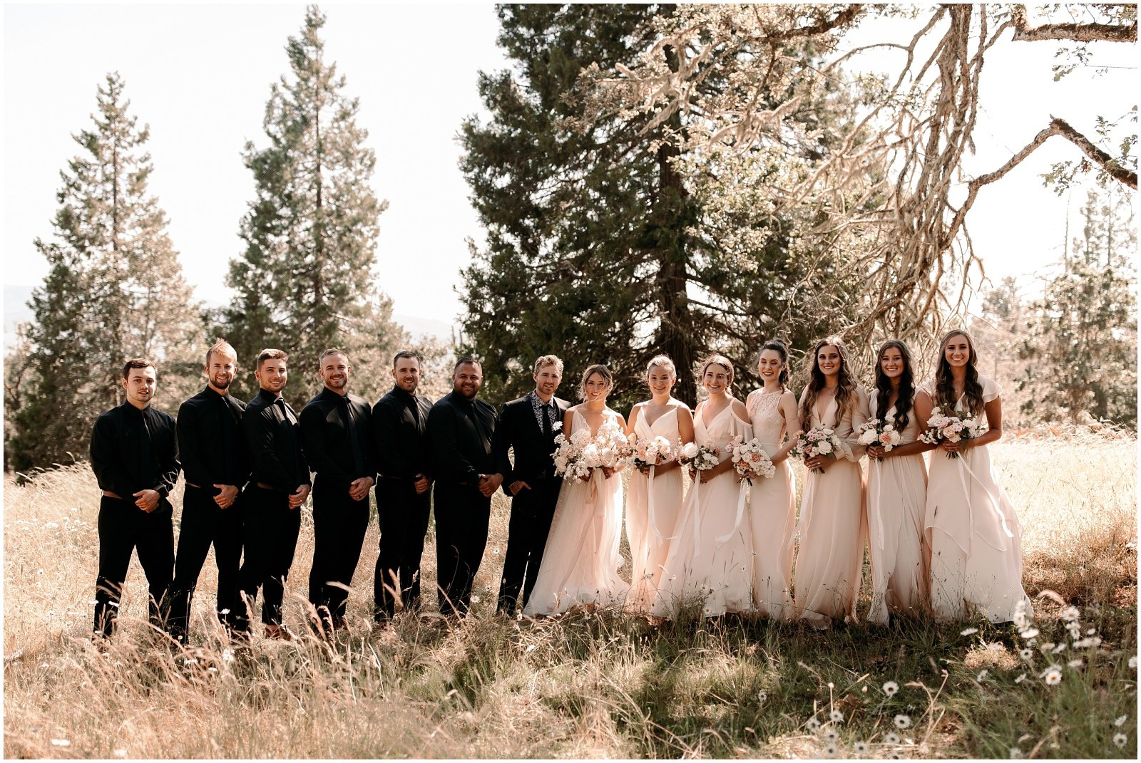 bride and bridesmaids wearing blush dresses and holding white and blush bouquets for their wedding in oregon