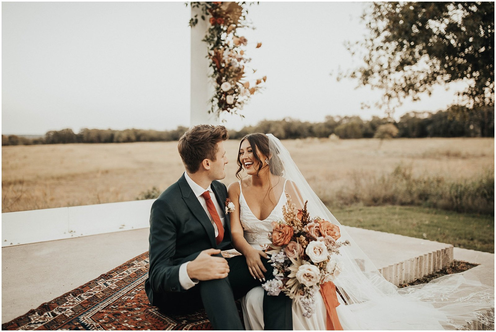 bride and groom portraits, bride is holding an autumn toned bridal bouquet