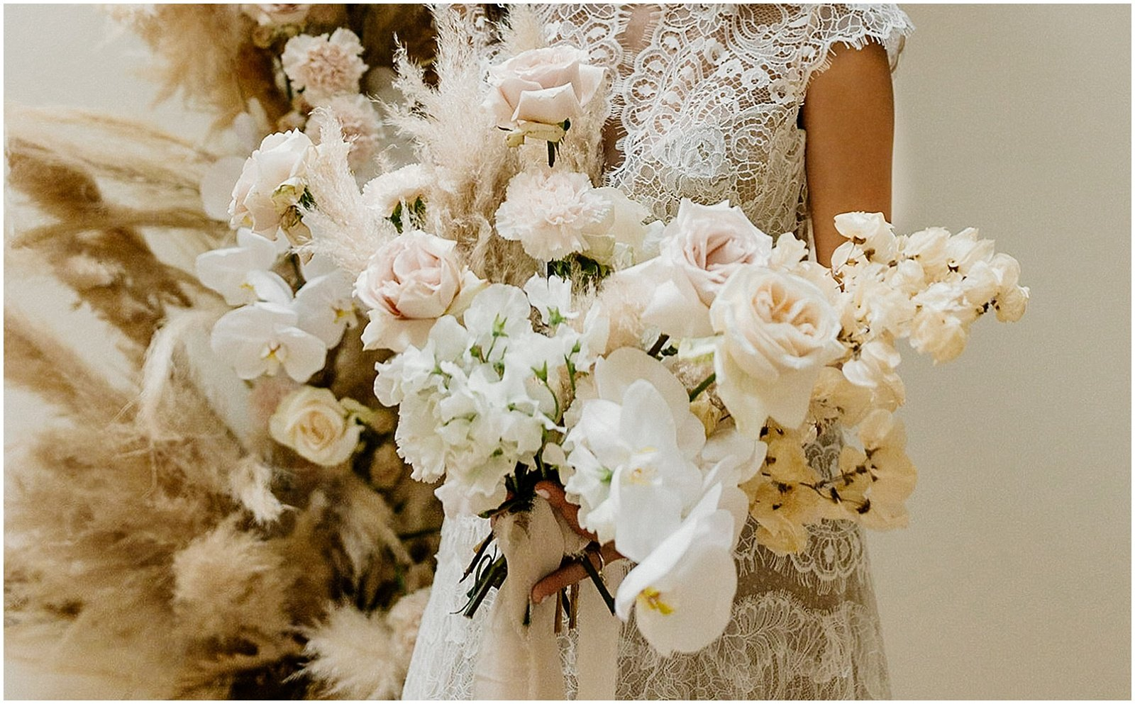blush and white bridal bouquet with pampas grass
