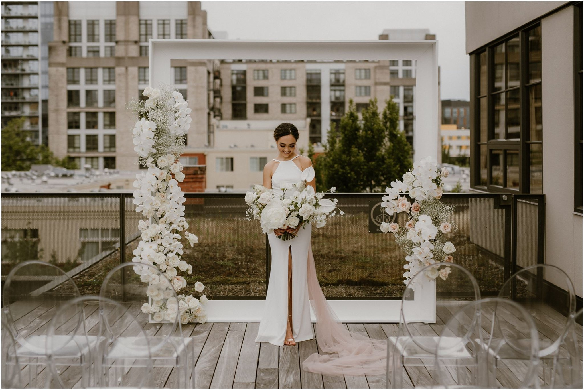 wedding ceremony set up with white florals on the rooftop of ecotrust building in downtown Portland