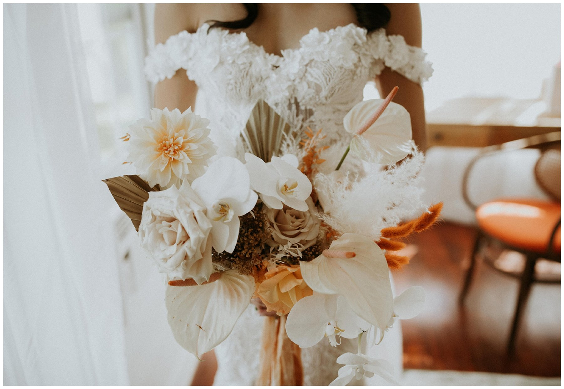 white and orange romantic bridal bouquet by good seed floral