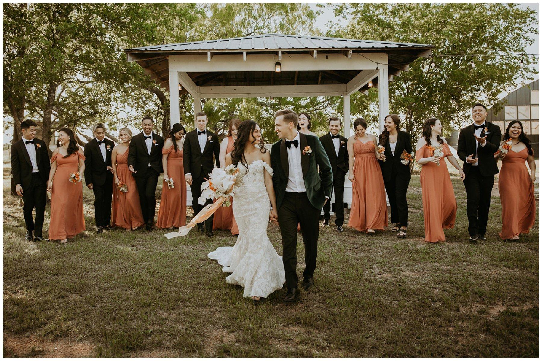 bridesmaids wearing rusty orange bridesmaid dresses