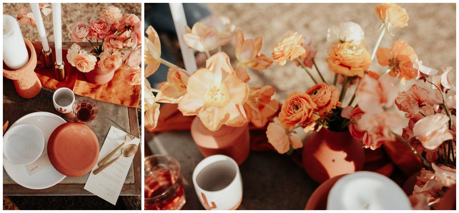Wedding dinner set up in the desert, candles and terracotta bud vases
