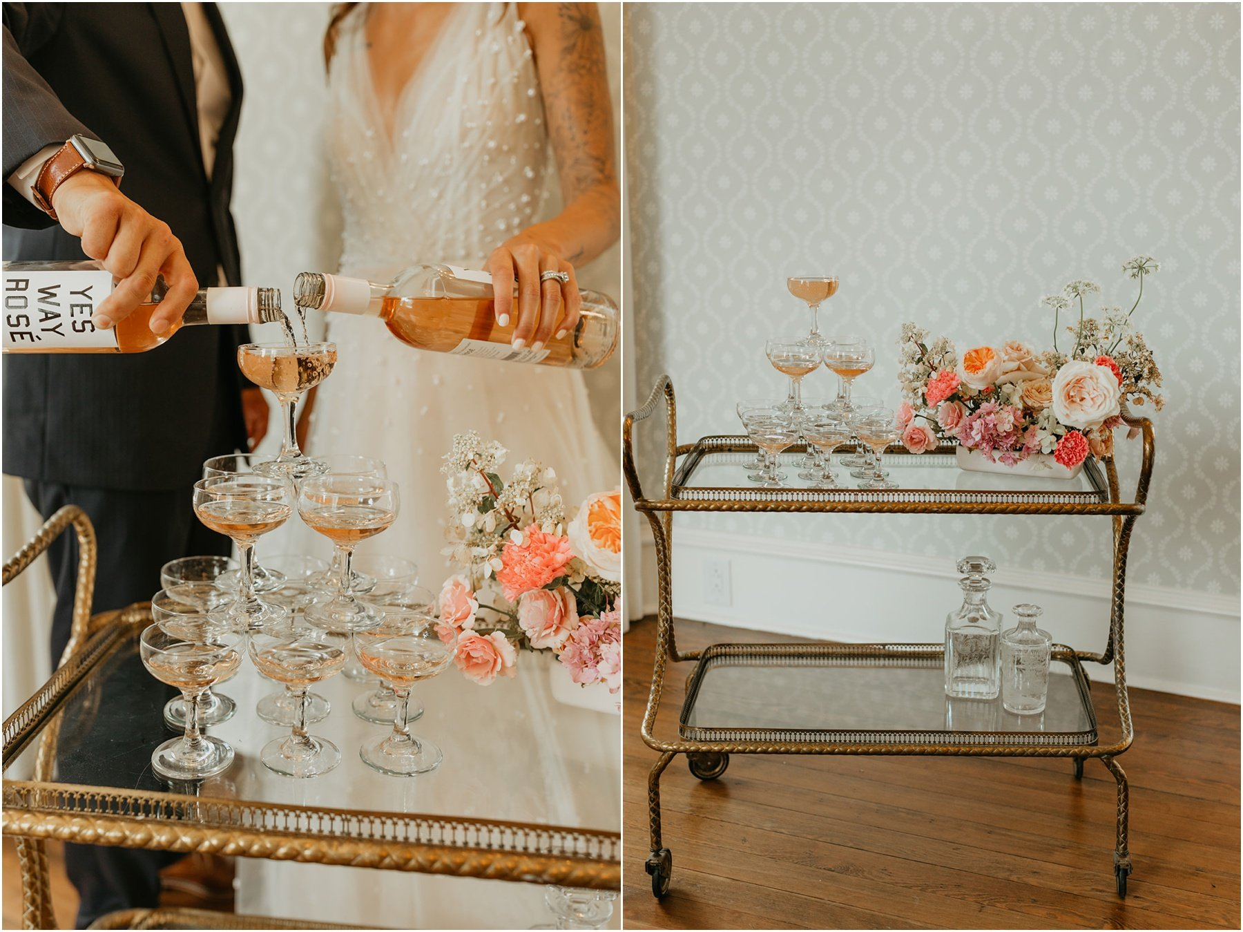 bride and groom pouring rose into a champagne tower on top of a vintage bar cart at woodbine mansion