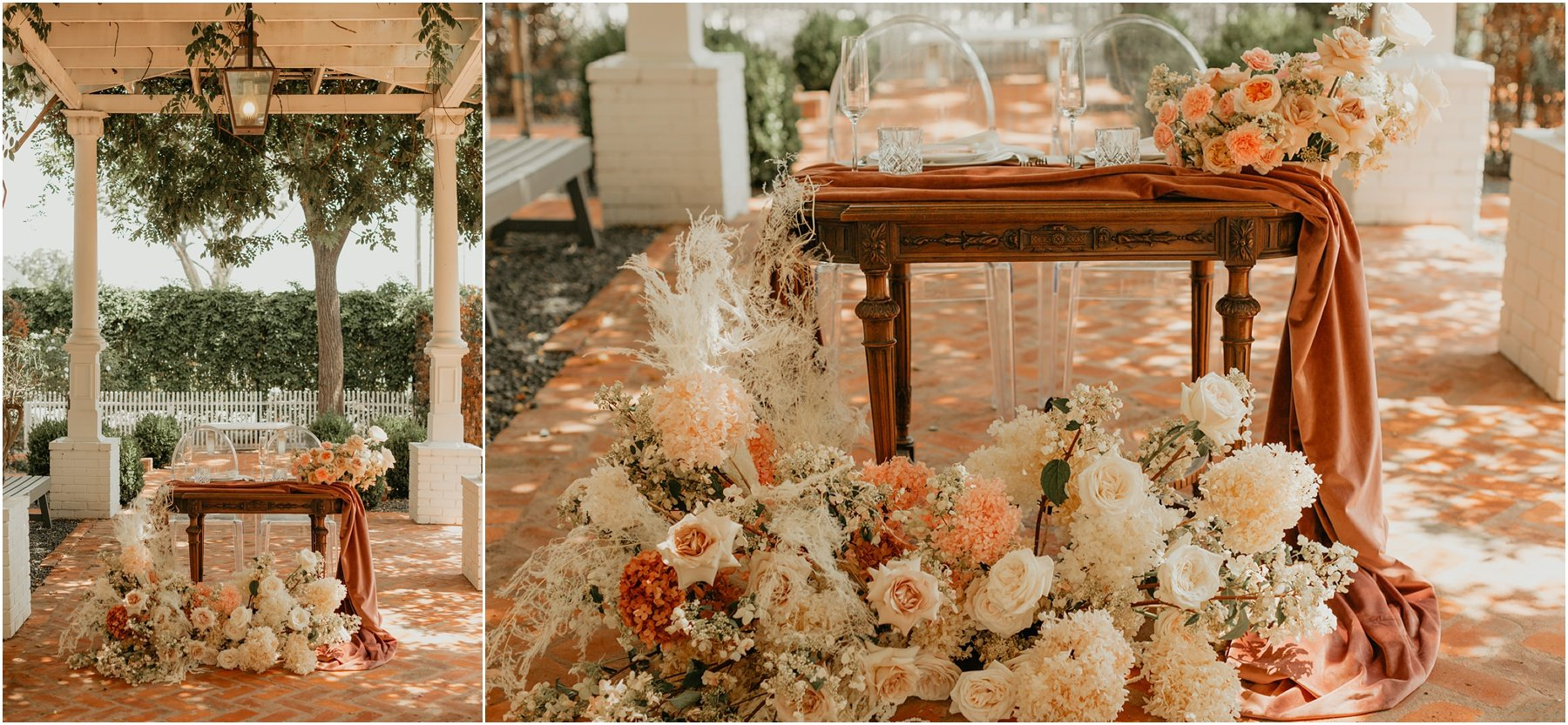 lush and romantic floral installation of roses and fluffy blooms in front of a sweetheart table at woodbine mansion