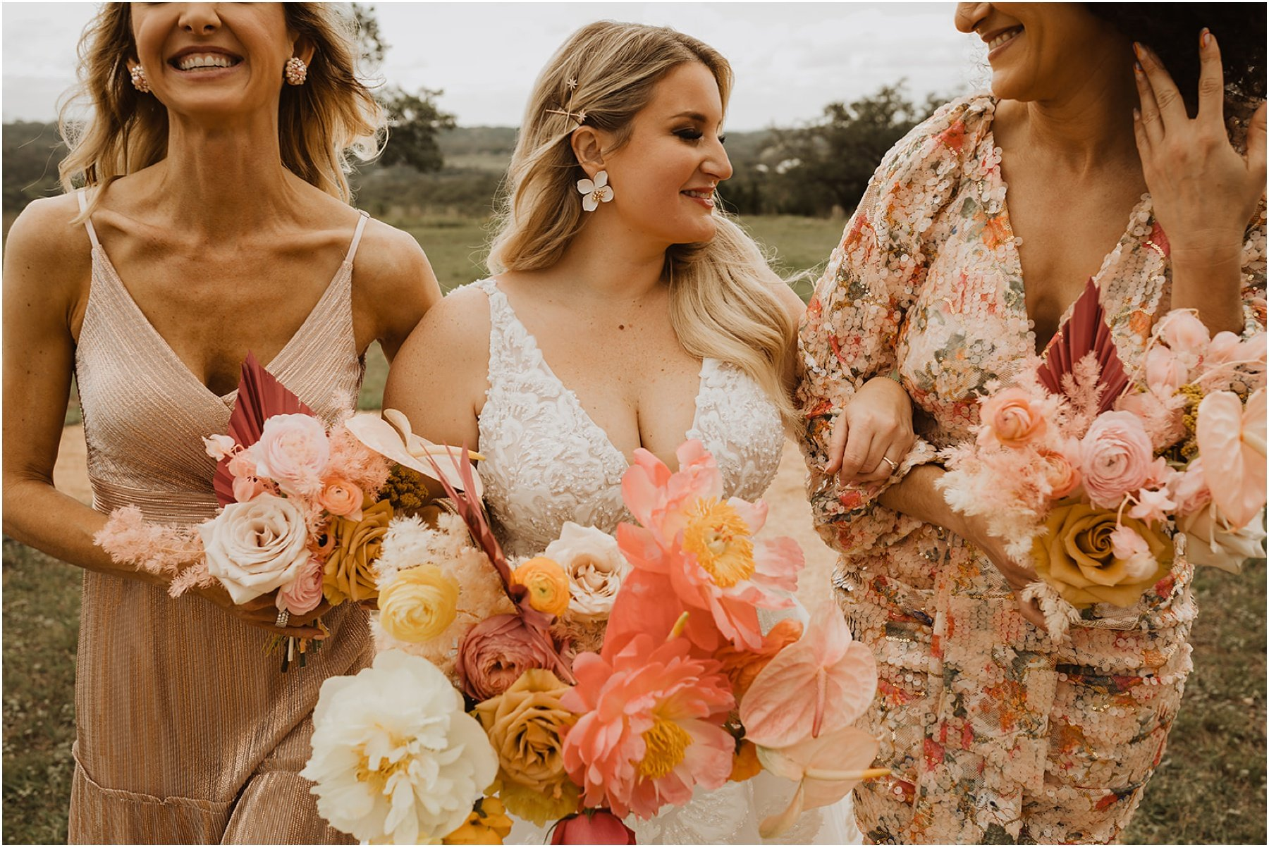 bride and bridesmaids carrying a bright and colorful bouquet