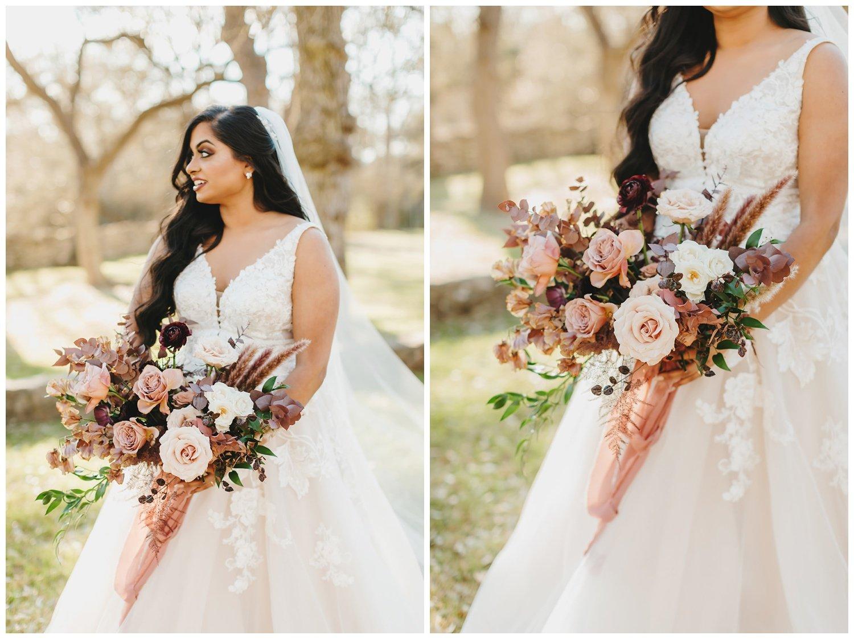 bride holding burgundy, blush and mauve bouquet